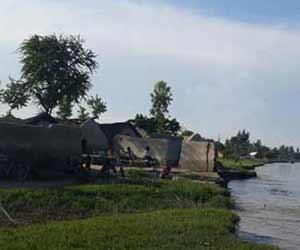 तस्वीरों में देखें-यूपी की नदियों का बढ़ता पानी