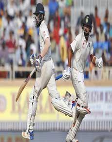photos: लोकेश राहुल ने जमाया अर्धशतक, भारत अब भी 331 रन पीछे