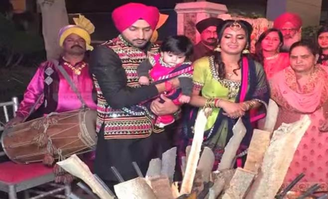 sports news, cricket news, celebrity couples, harbhajan singh, geeta basra, hinaya heer, lohri celebration, hinaya first lohri, cricket player