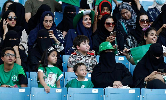 women attend football match,saudi football stadium,saudi arabia,king abdullah stadium,saudi women allowed,saudi women
