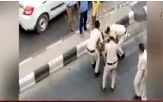 MHA seeks report from Delhi Police over video of cops thrashing a tempo..