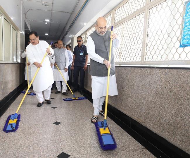Watch | Amit Shah sweeps floor at AIIMS, distributes gifts as part of 'Seva Saptah' campaign