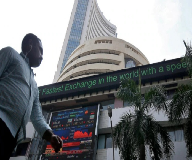 Sensex soars over 1,250 points, Nifty regains 9,100-mark as bank and auto stocks rally