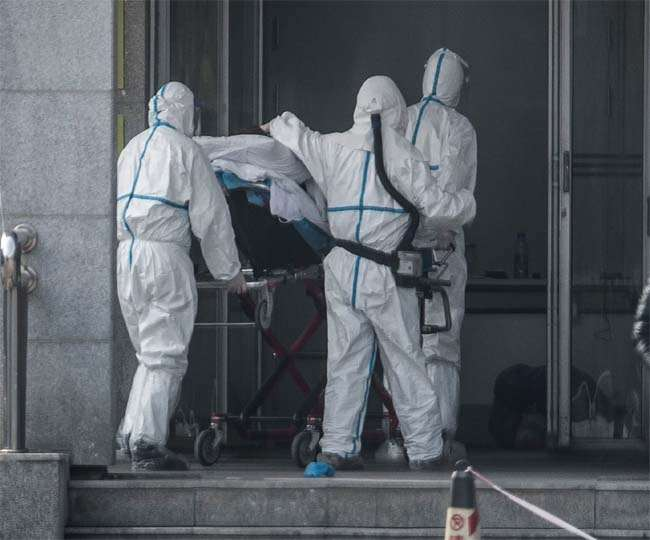 Virus death toll surges as China changes count method