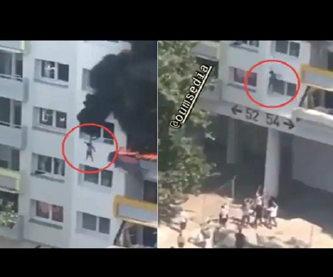 Caught on Camera: Two brothers' miraculous escape from burning apartment as they jump 40 feet and get caught