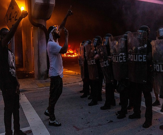 Curfews announced in several US cities after anti-police riots