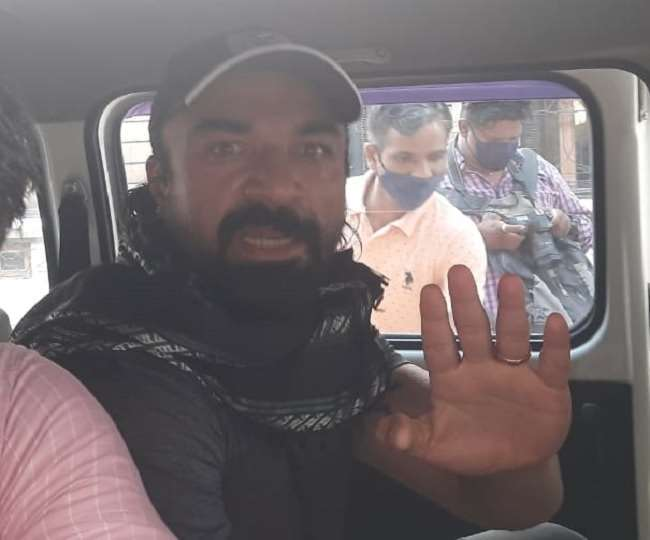 Ajaz Khan with NCB officials. File Photo- ANI