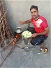 फौजी ने चूल्हे पर बनाई घीया की सब्जी