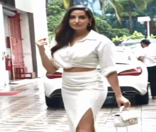 Nora Fatehi spotted outside an office, glamorous look in white dress. photo source @viralbhayani instagram.