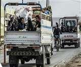 तुर्की से समझौते में दर्जनों वाहनों में सवार कुर्दों ने छोड़ा सीमावर्ती शहर रास अल आईन