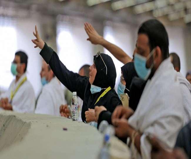 Pilgrims stone the devil with sanitized pebbles in hajj ritual