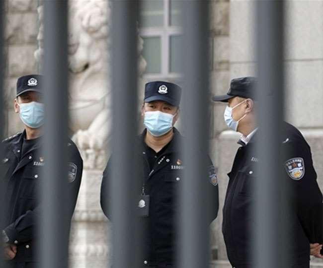 चीन में जासूसी में गिरफ्तार कनाडाई के खिलाफ चला ट्रायल। (फोटो: एपी)
