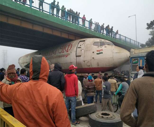 Image result for aircraft-stuck-under-bridge-west-bengal