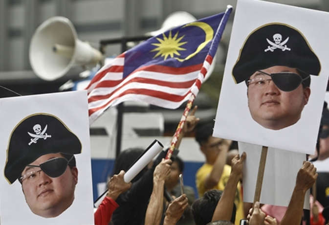 मलेशिया भ्रष्टाचार मामला : स्टेट फंड में हुए घोटाले का मास्टरमाइंड मकाउ फरार