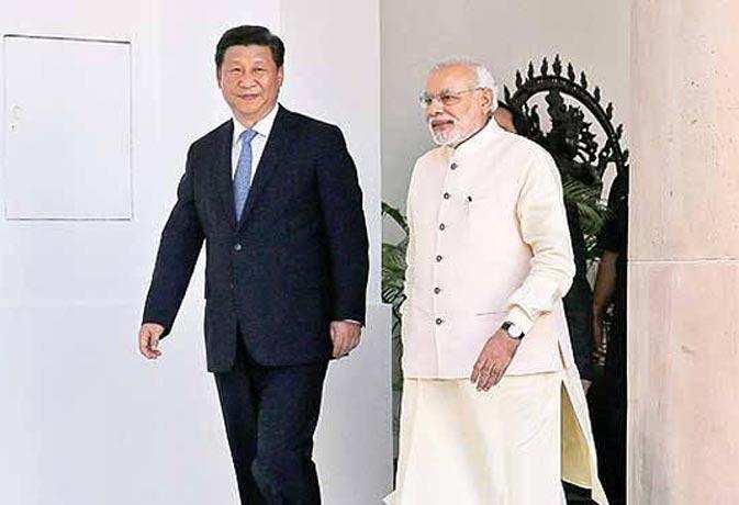 जंग की धमकी के बीच मोदी को भारतीय हितों के लिए खड़ा होने वाला नेता मानते हैं चिनफिंग