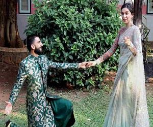 तस्वीरें : शादी के दिन किस खास वजह से काले छाते के पीछे मुंह छुपाते रहे दीप-वीर