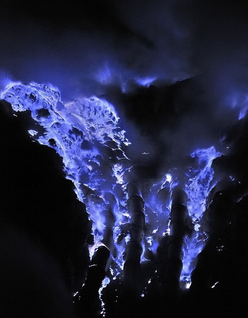 Indonesian Volcano erupts electric blue lava at night images and ...